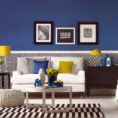 Modern blue living room Contrasting colours are a great way to make a statement. Large dark coloured areas, like ultramarine or even black, need bright coloured accessories to draw attention to key elements.