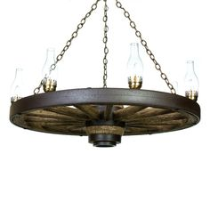 22 best wagon wheel chandeliers images on pinterest wagen wheels the large wagon wheel chandelier is a great choice for a rustic decor themed area due mozeypictures Choice Image