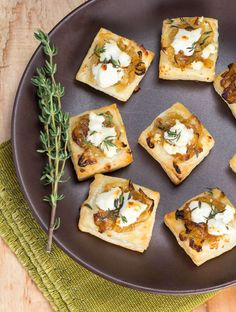 Need an easy but elegant holiday appetizer? Try these Cheesy Onion Puff Pastry Bites made with caramelized onions, goat cheese, thyme and frozen puff pastry.
