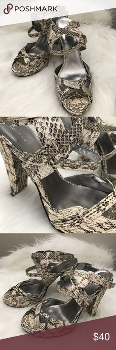"""CALVIN KLEIN Snakeskin Strappy Heels BRAND NEW NEVER WORN. NO BOX. Gorgeous Calvin Klein black and and ivory snakeskin heels. Criss cross straps in front and along the ankles. Silver insole with black bottoms. Beautiful and classic style. Heel measures 5"""" inches. Calvin Klein Shoes Heels"""