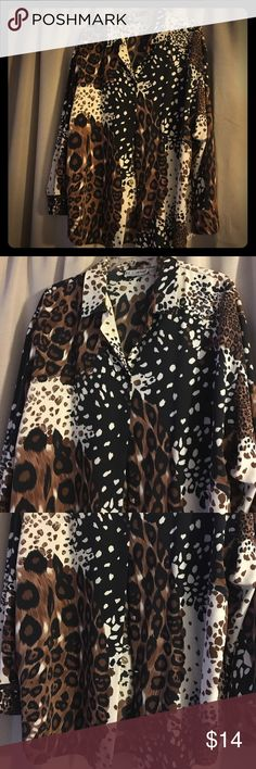 MAKE AN OFFER‼️Le Cavair AnimalPrintBlouse Size XL Le Caviar Womens Blouse  Animal Print  Size XL  A great ladies blouse perfect for that night out.... Look great in this stylish shirt. A very nice unique animal print. The blouse is in very good condition and is made of 100% polyester. There are no stains, rips, tears or missing buttons. le cavair Tops Blouses