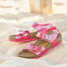 awesome  Like Mother Like Daughter The Shiny Snake finish also adorns sandals for smaller...
