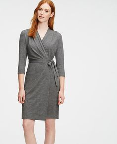 "Dress for success: in sweater-effect jersey, this wrap dress is the best of both worlds - polished for day, sophisticated for night. V-neck with crossover front. 3/4 sleeves. Tucked forward shoulder seams. Self tie belt. 21 1/2"" from natural waist."