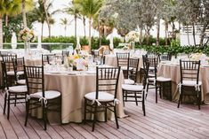 Flower's:  Thoughts on having some tables with manzanita trees  other tables with a lower box centerpiece?  For a staggering effect.