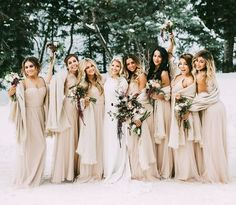 We adore these champagne bridesmaid dresses for a winter wedding.  Such a classy and organic look with their greenery and marsala bouquets.