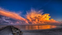 Thunderstorms off The North Jetty in Nokomis, Fl catching some beautiful color at sunrise the morning of 8-29-14. It was a really frustrating line of thunderstorms that moved up the coast and really kicked off 40 miles north of me (which would have been some crappy traffic to get through) after the sun came up.