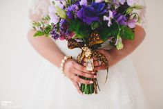 Roar!  Purple and cheetah ribbon bouquet from Fena Flowers.  Seattle Wedding from Tonhya Kae Photography + VOWS Wedding & Event Planning Read more - http://www.stylemepretty.com/little-black-book-blog/2013/11/22/seattle-wedding-from-tonhya-kae-photography-vows-wedding-and-event-planning/