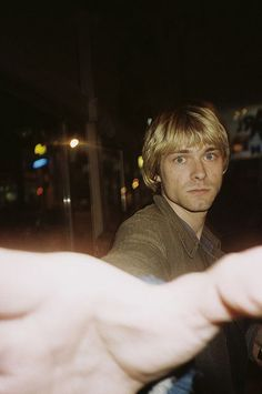 Kurt Cobain blocking camera with handotos