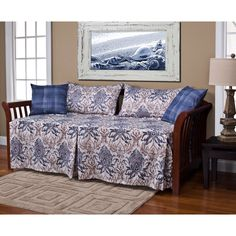 This five-piece daybed ensemble features an updated traditional baroque motif daybed cover, two king shams and two 20-inch decorative pillows. The washed colonial blue and sand ensemble is conveniently machine washable.