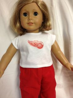 18 inch doll size t-shirt. White t-shirt with red Detroit Red Wings logo on it. Perfect for the little hockey fan in your life.