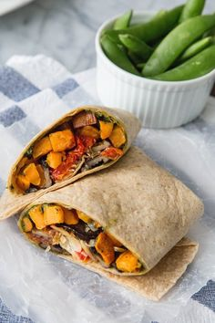 Wraps are pretty much on par with salads in the battle of sexy lunch dishes. Bust out of the boring wrap rut with this sweet and savory combination: sweet potatoes coated with pesto, rounded off with caramelized onions, oven roasted cherry tomatoes, and Parmesan. And better yet, make two weeks' worth and stock up your freezer!