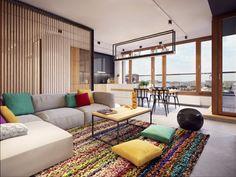 salon contemporain aménagé avec un canapé modulable gris, un tapis bariolé et une cloison en lattes de bois