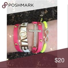 """Bracelet Neon Yellow Fuchsia Love Infinity Leather 1. A fuchsia leather skinny wrap bracelet (wraps around the wrist three times) with gold studs and a sparkling rhinestone cross. Belt buckle style closure with multiple size holes.  2. White leather bracelet with large gold """"LOVE"""" wording. Snap closure with two optional sizes.  3. A yellow neon cord woven bracelet with rhinestone sparkling infinity symbol. Pull string closure for size adjustment Jewelry Bracelets"""