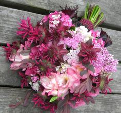 For a one of a kind summer wedding bouquet, include Monarda or Bee Balm. This particular variety is called Raspberry Wine, and this bouquet also features hydrangea, gladiolus, and yarrow