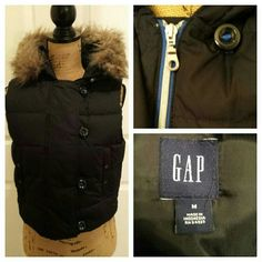 Cute black puffy vest with hood Never worn. NWOT.  Fur is removable GAP Jackets & Coats Vests