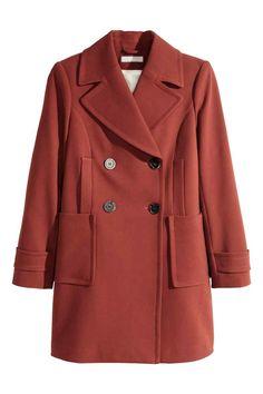 Manteau à double boutonnage: Manteau tissé à double boutonnage. Modèle avec col et revers larges, poches chauffe-mains et poches plaquées devant. Découpe soulignée d'une bande à la taille dans le dos. Patte décorative en bas de manche. Fente dans le dos. Doublé.