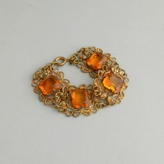 Hey, I found this really awesome Etsy listing at https://www.etsy.com/listing/177831123/art-deco-bracelet-amber-glass-faux