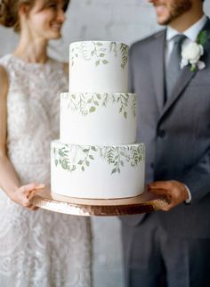 White Wedding Cakes Painted-on greens—including eucalyptus, olive leaves, and fern fronds—brought a hint of modern color to a smooth white three-tier treat by Hands On Sweets. - Get inspired by one of these unique confections. Floral Wedding Cakes, Wedding Cakes With Cupcakes, Elegant Wedding Cakes, Wedding Cake Designs, Rustic Wedding, Green Wedding Cakes, Wedding Cake Flowers, Beaded Wedding Cake, Different Wedding Cakes