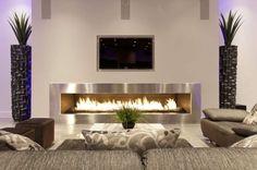 wohnzimmer design mit einem kamin und deko-pflanzen - Wie ein modernes Wohnzimmer aussieht – 135 innovative Designer Ideen