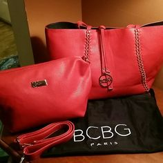 "BCBG Reversible tote with the Matching Small Bag Reversible chain trim Tote Bag,  Red/Black flat handles,  open top,  hanging logo charm, tote.  Bag comes with convertible Bag..  Tote measures 18""""h x 11""w x 4""D convertible bag measures 14""w x 8""h x 4""D BCBG Bags Totes"