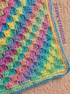 Red Heart Boutique Unforgettable yarn in Candied - in a simple C2C pattern.