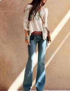 without a doubt one of my favorite looks. The bell bottom jeans with a flowey blouse and some clunky platform heels or and awesome pair of leather boots I love the 70's resemblance and the way bell bottoms fit with a cute big blouse and some brown leather!