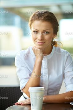 Portrait of young smiling business woman resting her chin on han | Stock Photo © Andrei Zarubaika #12478733