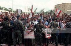 Christian Lebanese Army soldiers push Lebanese Christian students back while demonstrate 28 October 1989 in front of Baabda presidential palace in East Beirut against agreement reached by deputies and the Arab League Committee in Taif few days ago. After a month of intense discussion, in October 1989, the deputies informally agreed on a charter of national reconciliation, also known as Taif agreement. The Lebanese civil war broken out in April 1975.