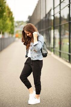 White teeblack jogger pantswhite sneakersdenim jacketblack and