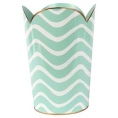 """Hand-painted wastebasket in aqua with ring handles. Crafted of recycled metal.  Product: WastebasketConstruction Material: Recycled metalColor: AquaFeatures:  Lead-freeHand-painted Dimensions: 12"""" H x 7"""" W x 6"""" D"""