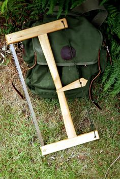 Nice looking wooden bucksaw, with cool toggle.