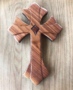Cross of Lilies in Walnut Divinecrosses.com #divinecrosses #handmadewoodcrosses #cross #religiousart #handcarvedcrosses