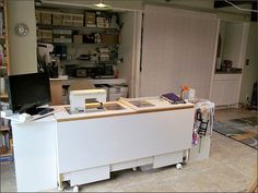 Sewing area and alcove by Needleloca, via Flickr - alcove contains beading supplies, needlepoint canvases, a paper cutting station, and photo boxes that hold other supplies.