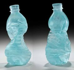 Melted glass bottles by Erwin Timmers. www.ecoglassart.com