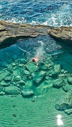Giola lagoon in Thassos, Greece. Giola is a beautiful natural lagoon, is like a swimming pool beautifully carved into the rocks.