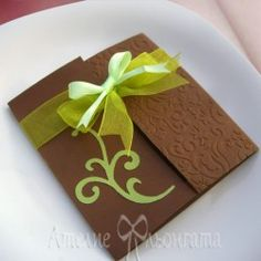 Wedding invitation handmade of embossed cardstock with dimensions 14 x 14 cm and ribbons. Custom colors by choice.