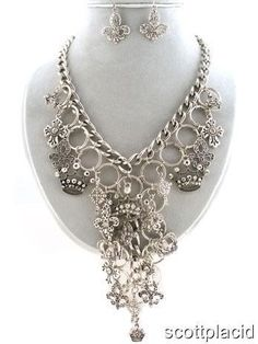 "CHUNKY FLEUR DE LIS, CROWN, AND CROSS CHARM SILVER TONE METAL NECKLACE SET WITH CRYSTAL ACCENTS    * If you need a necklace extender I have them for sale in my store.*        HOOK EARRINGS    DROP: 5""       16"" LONG/ 3"" EXT       COLOR: SILVER TONE $24.99"