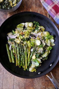 Brussels sprouts & kale sauteed in olive oil and tossed with white wine vinegar then topped with roasted asparagus.  Easy, quick and healthy for everyone.