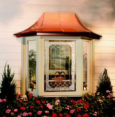 Bay window with casement side vents decorative glass and optional copper roof. Learn more at soft-lite.com