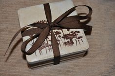 stamped coaster tiles - My SIL got something similar for Christmas from her boss with her initial on it.  Very cute!