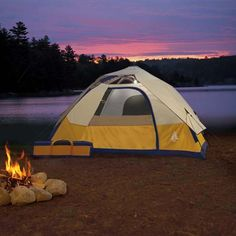Doesn't this look Relaxing? Oh Yes a Tent , a Campfire, The Lake Etc...... That is camping