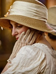 Downton Abbey:  The neckline detailing on this dress is gorgeous and the hat and gloves the perfect accessory.