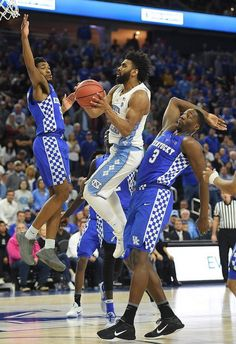 Joel Berry II #2 of the North Carolina Tar Heels is fouled as he drives to the basket between Malik Monk #5 and Edrice Adebayo #3 of the Kentucky Wildcats during the CBS Sports Classic at T-Mobile Arena on December 17, 2016 in Las Vegas, Nevada. Kentucky won 103-100.