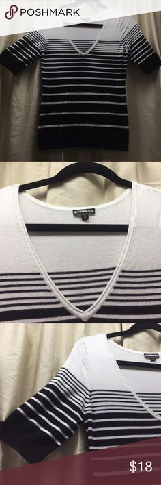 Black and white stripped sweater Black & white stripped sweater with shirt sleeves & V-Neck .. Express Sweaters V-Necks