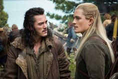 "Luke Evans as Bard the Bowman (left) and Orlando Bloom as Legolas Greenleaf in ""The Hobbit: Battle Of Five Armies"" (2014)"