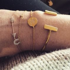 Missoma Gold Vermeil Horseshoe and Arrow Stacking Bracelets.