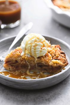 Easiest and best ever apple crumble pie with a pie crust bottom, gooey cinnamon apple filling, crumble topping, vanilla ice cream, and warm caramel sauce.