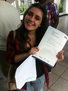 A-level results at Haringey Sixth Form Centre in North London 2014 - female student getting BTEC success.
