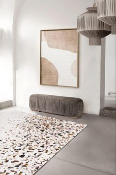 This entryway has the WALES Bench and the rug Terrazzo by Rug'Society.