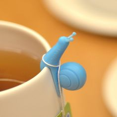 Snail Tea Bag Holders by Soulfun Design  These snails are officially the most adorable tea drinking accessory ever. Ever. Bonus points if you order the enter set (of 6) to use as glass markers for a party.